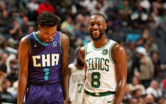 CHARLOTTE, NC - NOVEMBER 7: Malik Monk #1 of the Charlotte Hornets and Kemba Walker #8 of the Boston Celtics smile during a game on November 7, 2019 at Spectrum Center in Charlotte, North Carolina. NOTE TO USER: User expressly acknowledges and agrees that, by downloading and or using this photograph, User is consenting to the terms and conditions of the Getty Images License Agreement.  Mandatory Copyright Notice:  Copyright 2019 NBAE (Photo by Kent Smith/NBAE via Getty Images)