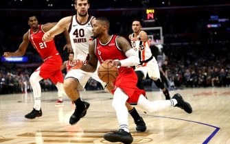 LOS ANGELES, CALIFORNIA - NOVEMBER 07:  Damian Lillard #0 of the Portland Trail Blazers dribbles past Ivica Zubac #40 of the Los Angeles Clippers during the first half of a game at Staples Center on November 07, 2019 in Los Angeles, California. NOTE TO USER: User expressly acknowledges and agrees that, by downloading and/or using this photograph, user is consenting to the terms and conditions of the Getty Images License Agreement (Photo by Sean M. Haffey/Getty Images)