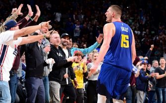 DENVER, CO - NOVEMBER 8: Nikola Jokic #15 of the Denver Nuggets reacts to a play against the Philadelphia 76ers on November 8, 2019 at the Pepsi Center in Denver, Colorado. NOTE TO USER: User expressly acknowledges and agrees that, by downloading and/or using this Photograph, user is consenting to the terms and conditions of the Getty Images License Agreement. Mandatory Copyright Notice: Copyright 2019 NBAE (Photo by Bart Young/NBAE via Getty Images)