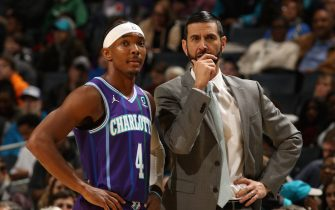CHARLOTTE, NC - NOVEMBER 9: Devonte' Graham #4 of the Charlotte Hornets and Head Coach, James Borrego of the Charlotte Hornets look on during the game against the New Orleans Pelicans on November 9, 2019 at Spectrum Center in Charlotte, North Carolina. NOTE TO USER: User expressly acknowledges and agrees that, by downloading and or using this photograph, User is consenting to the terms and conditions of the Getty Images License Agreement.  Mandatory Copyright Notice:  Copyright 2019 NBAE (Photo by Brock Williams-Smith/NBAE via Getty Images)
