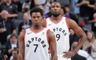 SACRAMENTO, CA - NOVEMBER 7: Kyle Lowry #7 and Serge Ibaka #9 of the Toronto Raptors look on during the game against the Sacramento Kings on November 7, 2018 at Golden 1 Center in Sacramento, California. NOTE TO USER: User expressly acknowledges and agrees that, by downloading and or using this photograph, User is consenting to the terms and conditions of the Getty Images Agreement. Mandatory Copyright Notice: Copyright 2018 NBAE (Photo by Rocky Widner/NBAE via Getty Images)
