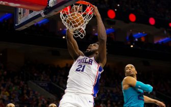 PHILADELPHIA, PA - NOVEMBER 10: Joel Embiid #21 of the Philadelphia 76ers goes up for a dunk against PJ Washington #25 of the Charlotte Hornets in the second quarter at the Wells Fargo Center on November 10, 2019 in Philadelphia, Pennsylvania. NOTE TO USER: User expressly acknowledges and agrees that, by downloading and/or using this photograph, user is consenting to the terms and conditions of the Getty Images License Agreement.  (Photo by Mitchell Leff/Getty Images)