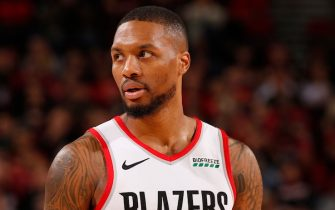 PORTLAND, OR - NOVEMBER 10: Damian Lillard #0 of the Portland Trail Blazers looks on against the Atlanta Hawks on November 10, 2019 at the Moda Center Arena in Portland, Oregon. NOTE TO USER: User expressly acknowledges and agrees that, by downloading and or using this photograph, user is consenting to the terms and conditions of the Getty Images License Agreement. Mandatory Copyright Notice: Copyright 2019 NBAE (Photo by Cameron Browne/NBAE via Getty Images)