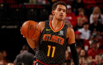 PORTLAND, OR - NOVEMBER 10: Trae Young #11 of the Atlanta Hawks handles the ball against the Portland Trail Blazers on November 10, 2019 at the Moda Center Arena in Portland, Oregon. NOTE TO USER: User expressly acknowledges and agrees that, by downloading and or using this photograph, user is consenting to the terms and conditions of the Getty Images License Agreement. Mandatory Copyright Notice: Copyright 2019 NBAE (Photo by Cameron Browne/NBAE via Getty Images)