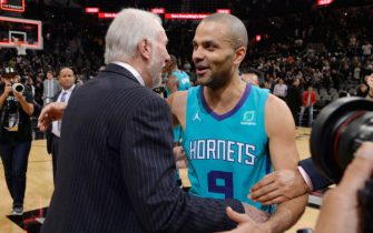 SAN ANTONIO, TX - JANUARY 14: Tony Parker #9 of the Charlotte Hornets and Gregg Popovich of the San Antonio Spurs embrace following the game on January 14, 2019 at the AT&T Center in San Antonio, Texas. NOTE TO USER: User expressly acknowledges and agrees that, by downloading and or using this photograph, user is consenting to the terms and conditions of the Getty Images License Agreement. Mandatory Copyright Notice: Copyright 2019 NBAE (Photos by Mark Sobhani/NBAE via Getty Images)