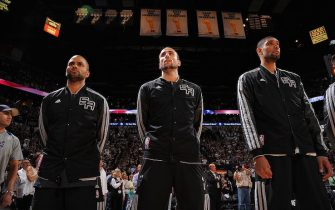 SAN ANTONIO, TX - MAY 6: Tony Parker #9 , Manu Ginobili #20 and Tim Duncan #21 of the San Antonio Spurs listen to the Star Spangled Banner prior to the game against the Golden State Warriors in Game One of the Western Conference Semifinals during the 2013 NBA Playoffs on May 6, 2013 at the AT&T Center in San Antonio, Texas.  NOTE TO USER: User expressly acknowledges and agrees that, by downloading and or using this photograph, User is consenting to the terms and conditions of the Getty Images License Agreement. Mandatory Copyright Notice: Copyright 2013 NBAE  (Photo by Andrew D. Bernstein/NBAE via Getty Images)