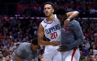 LOS ANGELES, CALIFORNIA - NOVEMBER 11:  Landry Shamet #20 of the LA Clippers is helped off the court by Patrick Beverley #21 during a 98-88 Clippers win over the Toronto Raptors at Staples Center on November 11, 2019 in Los Angeles, California.  NOTE TO USER: User expressly acknowledges and agrees that, by downloading and/or using this photograph, user is consenting to the terms and conditions of the Getty Images License Agreement. (Photo by Harry How/Getty Images)