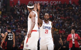 LOS ANGELES, CA - NOVEMBER 11: Patrick Beverley #21 of the LA Clippers and Maurice Harkless #8 of the LA Clippers celebrate during the game against the Toronto Raptors on November 11, 2019 at STAPLES Center in Los Angeles, California. NOTE TO USER: User expressly acknowledges and agrees that, by downloading and/or using this Photograph, user is consenting to the terms and conditions of the Getty Images License Agreement. Mandatory Copyright Notice: Copyright 2019 NBAE (Photo by Adam Pantozzi/NBAE via Getty Images)
