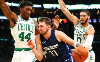 BOSTON, MA - NOVEMBER 11:  Luka Doncic #77 of the Dallas Mavericks dribbles the ball while guarded by Robert Williams III #44 of the Boston Celtics and Jayson Tatum #0 of the Boston Celtics during a game at TD Garden on November 11, 2019 in Boston, Massachusetts. NOTE TO USER: User expressly acknowledges and agrees that, by downloading and or using this photograph, User is consenting to the terms and conditions of the Getty Images License Agreement. (Photo by Adam Glanzman/Getty Images)