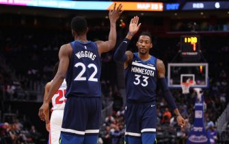 DETROIT, MICHIGAN - NOVEMBER 11: Robert Covington #33 of the Minnesota Timberwolves celebrates a first half basket with Andrew Wiggins #22 while playing the Detroit Pistons at Little Caesars Arena on November 11, 2019 in Detroit, Michigan.  NOTE TO USER: User expressly acknowledges and agrees that, by downloading and or using this photograph, User is consenting to the terms and conditions of the Getty Images License Agreement. (Photo by Gregory Shamus/Getty Images)