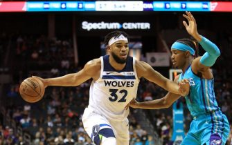 CHARLOTTE, NORTH CAROLINA - OCTOBER 25: Karl-Anthony Towns #32 of the Minnesota Timberwolves drives to the basket against Devonte' Graham #4 of the Charlotte Hornets during their game at Spectrum Center on October 25, 2019 in Charlotte, North Carolina. NOTE TO USER: User expressly acknowledges and agrees that, by downloading and or using this photograph, User is consenting to the terms and conditions of the Getty Images License Agreement. (Photo by Streeter Lecka/Getty Images)