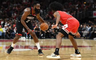 CHICAGO, ILLINOIS - NOVEMBER 09:  James Harden #13 of the Houston Rockets is defended by Coby White #0 of the Chicago Bulls during the first half of a game at United Center on November 09, 2019 in Chicago, Illinois. NOTE TO USER: User expressly acknowledges and agrees that, by downloading and or using this photograph, User is consenting to the terms and conditions of the Getty Images License Agreement. (Photo by Stacy Revere/Getty Images)
