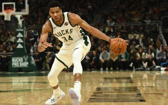 MILWAUKEE, WISCONSIN - NOVEMBER 27:  Giannis Antetokounmpo #34 of the Milwaukee Bucks handles the ball during a game against the Atlanta Hawks at Fiserv Forum on November 27, 2019 in Milwaukee, Wisconsin. NOTE TO USER: User expressly acknowledges and agrees that, by downloading and or using this photograph, User is consenting to the terms and conditions of the Getty Images License Agreement. (Photo by Stacy Revere/Getty Images)