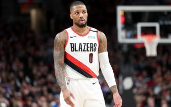 PORTLAND, OREGON - FEBRUARY 01: Damian Lillard #0 of the Portland Trail Blazers reacts in the first quarter against the Utah Jazz during their game at Moda Center on February 01, 2020 in Portland, Oregon. NOTE TO USER: User expressly acknowledges and agrees that, by downloading and or using this photograph, User is consenting to the terms and conditions of the Getty Images License Agreement. (Photo by Abbie Parr/Getty Images)