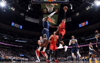 DENVER, CO - NOVEMBER 12: Trae Young #11 of the Atlanta Hawks drives to the basket during a game against the Denver Nuggets on November 12, 2019 at the Pepsi Center in Denver, Colorado. NOTE TO USER: User expressly acknowledges and agrees that, by downloading and/or using this Photograph, user is consenting to the terms and conditions of the Getty Images License Agreement. Mandatory Copyright Notice: Copyright 2019 NBAE (Photo by Garrett Ellwood/NBAE via Getty Images)