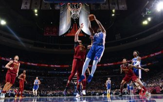 PHILADELPHIA, PA - NOVEMBER 12: Joel Embiid #21 of the Philadelphia 76ers grabs the rebound against the Cleveland Cavaliers on November 10, 2019 at the Wells Fargo Center in Philadelphia, Pennsylvania NOTE TO USER: User expressly acknowledges and agrees that, by downloading and/or using this Photograph, user is consenting to the terms and conditions of the Getty Images License Agreement. Mandatory Copyright Notice: Copyright 2019 NBAE (Photo by Jesse D. Garrabrant/NBAE via Getty Images)