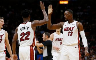 MIAMI, FLORIDA - NOVEMBER 12:  Jimmy Butler #22 of the Miami Heat celebrates with Bam Adebayo #13 against the Detroit Pistons during the second half at American Airlines Arena on November 12, 2019 in Miami, Florida. NOTE TO USER: User expressly acknowledges and agrees that, by downloading and/or using this photograph, user is consenting to the terms and conditions of the Getty Images License Agreement. (Photo by Michael Reaves/Getty Images)