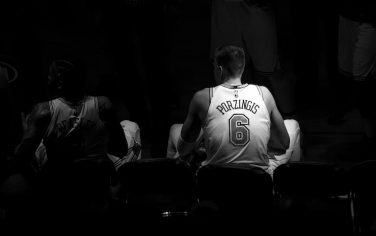 NEW YORK, NY - JANUARY 02: (EDITORS NOTE: This image has been converted to black and white) Kristaps Porzingis #6 of the New York Knicks during a timeout in the game against the San Antonio Spurs at Madison Square Garden on January 02, 2018 in New York City. NOTE TO USER: User expressly acknowledges and agrees that, by downloading and or using this photograph, User is consenting to the terms and conditions of the Getty Images License Agreement. (Photo by Matteo Marchi/Getty Images)