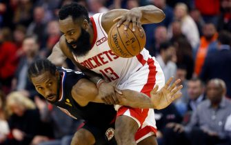 HOUSTON, TEXAS - NOVEMBER 13: James Harden #13 of the Houston Rockets is defended by Kawhi Leonard #2 of the Los Angeles Clippers during the fourth quarter at Toyota Center on November 13, 2019 in Houston, Texas. NOTE TO USER: User expressly acknowledges and agrees that, by downloading and/or using this photograph, user is consenting to the terms and conditions of the Getty Images License Agreement.  (Photo by Bob Levey/Getty Images)