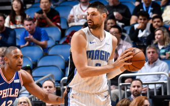 ORLANDO, FL - NOVEMBER 13: Nikola Vucevic #9 of the Orlando Magic handles the ball against the Philadelphia 76ers on November 13, 2019 at Amway Center in Orlando, Florida. NOTE TO USER: User expressly acknowledges and agrees that, by downloading and or using this photograph, User is consenting to the terms and conditions of the Getty Images License Agreement. Mandatory Copyright Notice: Copyright 2019 NBAE (Photo by Fernando Medina/NBAE via Getty Images)