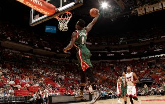 MIAMI, FL - NOVEMBER 16:  Larry Sanders #8 of the Milwaukee Bucks dunks against the Miami Heat during the game on November 16, 2014 at AmericanAirlines Arena in Miami, Florida. NOTE TO USER: User expressly acknowledges and agrees that, by downloading and or using this Photograph, user is consenting to the terms and conditions of the Getty Images License Agreement. Mandatory Copyright Notice: Copyright 2014 NBAE (Photo by Issac Baldizon/NBAE via Getty Images)