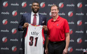 PORTLAND, OR - JULY 8: Festus Ezeli #31 of the Portland Trail Blazers is introduced to the media by Head Coach Terry Stotts July 8, 2016 at the Trail Blazer Practice Facility in Portland, Oregon. NOTE TO USER: User expressly acknowledges and agrees that, by downloading and or using this photograph, user is consenting to the terms and conditions of the Getty Images License Agreement. Mandatory Copyright Notice: Copyright 2016 NBAE (Photo by Sam Forencich/NBAE via Getty Images)