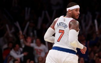 NEW YORK, NY - NOVEMBER 09:  Carmelo Anthony #7 of the New York Knicks reacts after hitting a three against the Brooklyn Nets during the second half at Madison Square Garden on November 9, 2016 in New York City. NOTE TO USER: User expressly acknowledges and agrees that, by downloading and or using this photograph, User is consenting to the terms and conditions of the Getty Images License Agreement.  (Photo by Michael Reaves/Getty Images)