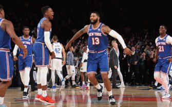 NEW YORK, NY - NOVEMBER 14: Frank Ntilikina #11 and Marcus Morris Sr. #13 of the New York Knicks celebrate during a game against the Dallas Mavericks on November 14, 2019 at Madison Square Garden in New York City, New York.  NOTE TO USER: User expressly acknowledges and agrees that, by downloading and or using this photograph, User is consenting to the terms and conditions of the Getty Images License Agreement. Mandatory Copyright Notice: Copyright 2019 NBAE  (Photo by Nathaniel S. Butler/NBAE via Getty Images)