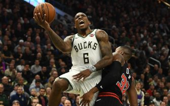 MILWAUKEE, WISCONSIN - NOVEMBER 14:  Eric Bledsoe #6 of the Milwaukee Bucks is fouled by Kris Dunn #32 of the Chicago Bulls at Fiserv Forum on November 14, 2019 in Milwaukee, Wisconsin. NOTE TO USER: User expressly acknowledges and agrees that, by downloading and or using this photograph, User is consenting to the terms and conditions of the Getty Images License Agreement. (Photo by Stacy Revere/Getty Images)