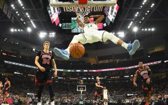 MILWAUKEE, WISCONSIN - NOVEMBER 14:  Giannis Antetokounmpo #34 of the Milwaukee Bucks dunks against the Chicago Bulls during the second half at Fiserv Forum on November 14, 2019 in Milwaukee, Wisconsin. NOTE TO USER: User expressly acknowledges and agrees that, by downloading and or using this photograph, User is consenting to the terms and conditions of the Getty Images License Agreement. (Photo by Stacy Revere/Getty Images)