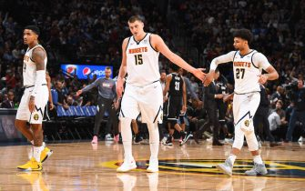 DENVER, CO - NOVEMBER 14: Nikola Jokic #15 and Jamal Murray #27 of the Denver Nuggets hi-five during a game against the Brooklyn Nets on November 14, 2019 at the Pepsi Center in Denver, Colorado. NOTE TO USER: User expressly acknowledges and agrees that, by downloading and/or using this Photograph, user is consenting to the terms and conditions of the Getty Images License Agreement. Mandatory Copyright Notice: Copyright 2019 NBAE (Photo by Garrett Ellwood/NBAE via Getty Images)