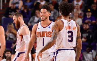 PHOENIX, AZ - NOVEMBER 14: Devin Booker #1 of the Phoenix Suns smiles during a game against the Atlanta Hawks on November 14, 2019 at Talking Stick Resort Arena in Phoenix, Arizona. NOTE TO USER: User expressly acknowledges and agrees that, by downloading and or using this photograph, user is consenting to the terms and conditions of the Getty Images License Agreement. Mandatory Copyright Notice: Copyright 2019 NBAE (Photo by Barry Gossage/NBAE via Getty Images)