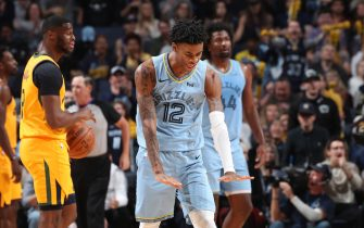 MEMPHIS, TN - NOVEMBER 15: Ja Morant #12 of the Memphis Grizzlies reacts to a play against the Utah Jazz on November 15, 2019 at FedExForum in Memphis, Tennessee. NOTE TO USER: User expressly acknowledges and agrees that, by downloading and or using this photograph, User is consenting to the terms and conditions of the Getty Images License Agreement. Mandatory Copyright Notice: Copyright 2019 NBAE (Photo by Joe Murphy/NBAE via Getty Images)