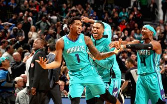 CHARLOTTE, NC - NOVEMBER 15: Charlotte Hornets players react to Malik Monk #1 of the Charlotte Hornets hitting the game winning shot against the Detroit Pistons on November 15, 2019 at Spectrum Center in Charlotte, North Carolina. NOTE TO USER: User expressly acknowledges and agrees that, by downloading and or using this photograph, User is consenting to the terms and conditions of the Getty Images License Agreement.  Mandatory Copyright Notice:  Copyright 2019 NBAE (Photo by Kent Smith/NBAE via Getty Images)