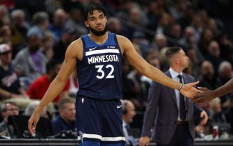 MINNEAPOLIS, MN -  NOVEMBER 15: Karl-Anthony Towns #32 of the Minnesota Timberwolves high fives his teammate during the game against the Washington Wizards on November 15, 2019 at Target Center in Minneapolis, Minnesota. NOTE TO USER: User expressly acknowledges and agrees that, by downloading and or using this Photograph, user is consenting to the terms and conditions of the Getty Images License Agreement. Mandatory Copyright Notice: Copyright 2019 NBAE (Photo by Jordan Johnson/NBAE via Getty Images)