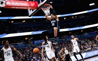 ORLANDO, FLORIDA - NOVEMBER 15: Aaron Gordon #00 of the Orlando Magic dunks against the San Antonio Spurs in first the quarter at Amway Center on November 15, 2019 in Orlando, Florida. NOTE TO USER: User expressly acknowledges and agrees that, by downloading and/or using this photograph, user is consenting to the terms and conditions of the Getty Images License Agreement. (Photo by Harry Aaron/Getty Images)