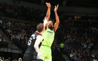 MINNEAPOLIS, MN -  NOVEMBER 16: Karl-Anthony Towns #32 of the Minnesota Timberwolves shoots the ball during a game against the Houston Rockets on November 16, 2019 at Target Center in Minneapolis, Minnesota. NOTE TO USER: User expressly acknowledges and agrees that, by downloading and or using this Photograph, user is consenting to the terms and conditions of the Getty Images License Agreement. Mandatory Copyright Notice: Copyright 2019 NBAE (Photo by David Sherman/NBAE via Getty Images)