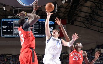 DALLAS, TX - NOVEMBER 16: Luka Doncic #77 of the Dallas Mavericks shoots the ball against the Toronto Raptors on November 16, 2019 at the American Airlines Center in Dallas, Texas. NOTE TO USER: User expressly acknowledges and agrees that, by downloading and or using this photograph, User is consenting to the terms and conditions of the Getty Images License Agreement. Mandatory Copyright Notice: Copyright 2019 NBAE (Photo by Glenn James/NBAE via Getty Images)