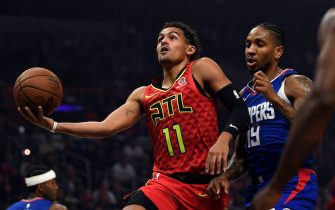 LOS ANGELES, CA - NOVEMBER 16: Trae Young #11 of the Atlanta Hawks drives to the basket as he is fouled by Rodney McGruder #19 of the Los Angeles Clippers at Staples Center on November 16, 2019 in Los Angeles, California. NOTE TO USER: User expressly acknowledges and agrees that, by downloading and/or using this Photograph, user is consenting to the terms and conditions of the Getty Images License Agreement (Photo by Kevork Djansezian/Getty Images)