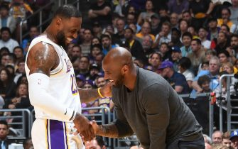 LOS ANGELES, CA - NOVEMBER 17: LeBron James #23 of the Los Angeles Lakers and NBA legend, Kobe Bryant smile before the game against the Atlanta Hawks on November 17, 2019 at STAPLES Center in Los Angeles, California. NOTE TO USER: User expressly acknowledges and agrees that, by downloading and/or using this Photograph, user is consenting to the terms and conditions of the Getty Images License Agreement. Mandatory Copyright Notice: Copyright 2019 NBAE (Photo by Andrew D. Bernstein/NBAE via Getty Images)