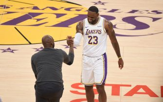 LOS ANGELES, CA - NOVEMBER 17: LeBron James #23 of the Los Angeles Lakers high fives NBA Legend Kobe Bryant during a game between the Los Angeles Lakers and Atlanta Hawks on November 17, 2019 at STAPLES Center in Los Angeles, California. NOTE TO USER: User expressly acknowledges and agrees that, by downloading and/or using this Photograph, user is consenting to the terms and conditions of the Getty Images License Agreement. Mandatory Copyright Notice: Copyright 2019 NBAE (Photo by Adam Pantozzi/NBAE via Getty Images)