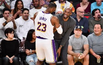 LOS ANGELES, CALIFORNIA - NOVEMBER 17: Kobe Bryant embraces LeBron James during a basketball game between the Los Angeles Lakers and the Atlanta Hawks at Staples Center on November 17, 2019 in Los Angeles, California. (Photo by Allen Berezovsky/Getty Images)