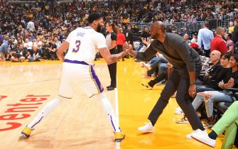 LOS ANGELES, CA - NOVEMBER 17: Anthony Davis #3 of the Los Angeles Lakers and NBA legend, Kobe Bryant high five before the game against the Atlanta Hawks on November 17, 2019 at STAPLES Center in Los Angeles, California. NOTE TO USER: User expressly acknowledges and agrees that, by downloading and/or using this Photograph, user is consenting to the terms and conditions of the Getty Images License Agreement. Mandatory Copyright Notice: Copyright 2019 NBAE (Photo by Andrew D. Bernstein/NBAE via Getty Images)
