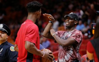 MIAMI, FLORIDA - NOVEMBER 16: Jimmy Butler #22 of the Miami Heat talks with Paul Pogba of Manchester United prior to the game against the New Orleans Pelicans at American Airlines Arena on November 16, 2019 in Miami, Florida. NOTE TO USER: User expressly acknowledges and agrees that, by downloading and/or using this photograph, user is consenting to the terms and conditions of the Getty Images License Agreement. (Photo by Michael Reaves/Getty Images)