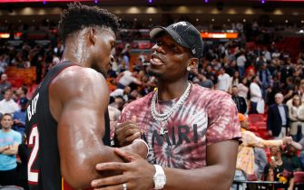 MIAMI, FLORIDA - NOVEMBER 16: Jimmy Butler #22 of the Miami Heat talks with Paul Pogba of Manchester United after the game against the New Orleans Pelicans at American Airlines Arena on November 16, 2019 in Miami, Florida. NOTE TO USER: User expressly acknowledges and agrees that, by downloading and/or using this photograph, user is consenting to the terms and conditions of the Getty Images License Agreement. (Photo by Michael Reaves/Getty Images)