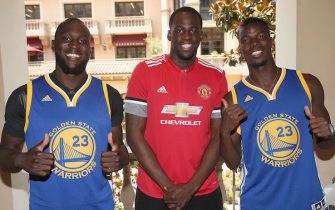 LOS ANGELES, CA - JULY 14: (EXCLUSIVE COVERAGE) Romelu Lukaku and Paul Pogba of Manchester United pose with Draymond Green of Golden State Warriores as part of their pre-season tour of the USA at UCLA on July 14, 2017 in Los Angeles, California.  (Photo by John Peters/Man Utd via Getty Images)