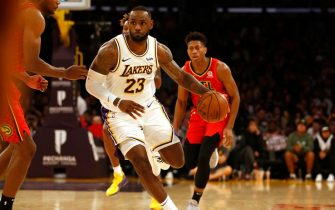 LOS ANGELES, CALIFORNIA - NOVEMBER 17:  LeBron James #23 of the Los Angeles Lakers moves the ball down the court during the second half of a game against the Atlanta Hawks at Staples Center on November 17, 2019 in Los Angeles, California. NOTE TO USER: User expressly acknowledges and agrees that, by downloading and or using this photograph, User is consenting to the terms and conditions of the Getty Images License Agreement. (Photo by Katharine Lotze/Getty Images)
