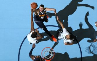 MEMPHIS, TN - JANUARY 28: Nikola Jokic #15 of the Denver Nuggets gets control of the ball against the Memphis Grizzlies on January 28, 2019 at FedExForum in Memphis, Tennessee. NOTE TO USER: User expressly acknowledges and agrees that, by downloading and or using this photograph, User is consenting to the terms and conditions of the Getty Images License Agreement. Mandatory Copyright Notice: Copyright 2019 NBAE (Photo by Joe Murphy/NBAE via Getty Images)