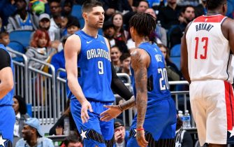 ORLANDO, FL - NOVEMBER 17: Markelle Fultz #20 and Nikola Vucevic #9 of the Orlando Magic hi-five during a game against the Washington Wizards on November 17, 2019 at Amway Center in Orlando, Florida. NOTE TO USER: User expressly acknowledges and agrees that, by downloading and or using this photograph, User is consenting to the terms and conditions of the Getty Images License Agreement. Mandatory Copyright Notice: Copyright 2019 NBAE (Photo by Fernando Medina/NBAE via Getty Images)
