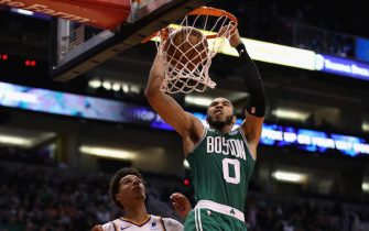 PHOENIX, ARIZONA - NOVEMBER 18: Jayson Tatum #0 of the Boston Celtics slam dunks the ball over Cameron Johnson #23 of the Phoenix Suns during the second half of the NBA game at Talking Stick Resort Arena on November 18, 2019 in Phoenix, Arizona. The Celtics defeated the Suns 99-85. NOTE TO USER: User expressly acknowledges and agrees that, by downloading and/or using this photograph, user is consenting to the terms and conditions of the Getty Images License Agreement  (Photo by Christian Petersen/Getty Images)
